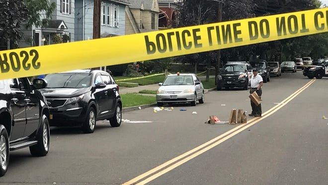 Binghamton police investigate a stabbing involving family members on Leroy Street on July 25, 2017.