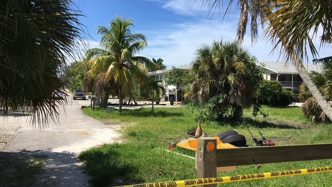 Crime scene tape cordons off homes on Fort Myers Beach's Lazy Way where a Lee County deputy shot and killed a woman Thursday night.