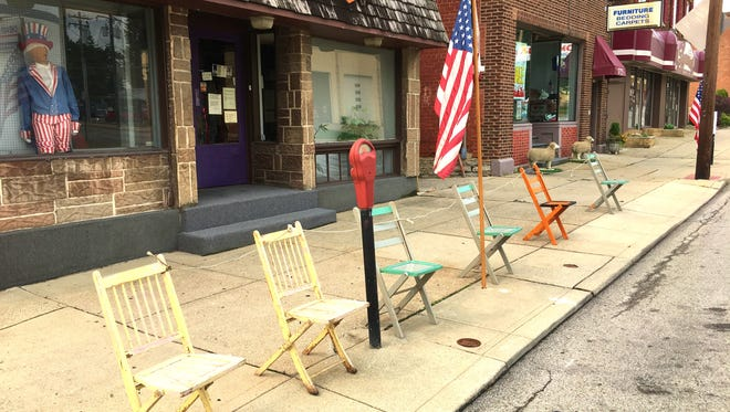 Chairs were already lined up on Harrison Avenue on Tuesday in anticipation of the Harvest Home Parade.