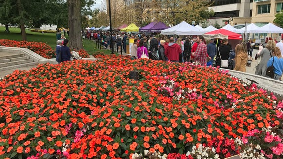 Thousands of people converge on Madison's capitol square for the Saturday morning Dane County Farmers' Market.