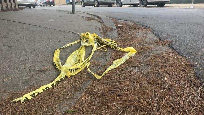 Crime scene tape lay on the ground Thursday morning at the scene of a homicide on Orchard Avenue in Salinas.