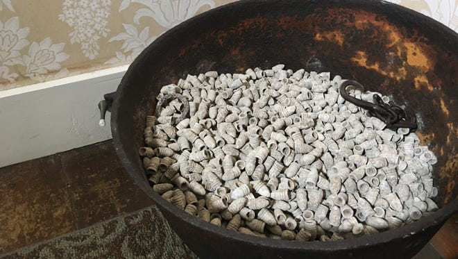 Now on display, visitors to the Lotz House can view 10,000 minni balls together in a cast iron cooking pot.