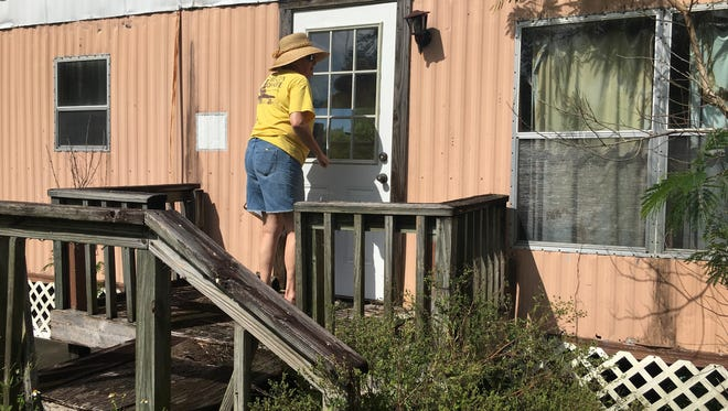 Caryle Regan, a board member of Pine Island United Way organization Beacon of Hope, makes the rounds of one of the island's mobile home parks, the Villas, to make sure residents are aware of the mandatory evacuation announced on Friday and let them know how to get to safe shelters off-island.
