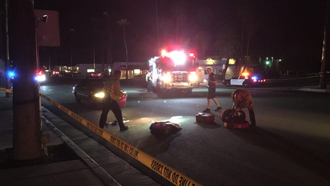 Palm Springs Police Department workers look at the scene of what is reported to be a car vs. pedestrian accident on S. Palm Canyon late Thursday night.