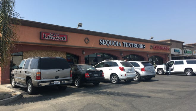 College of the Sequoias may purchase the lot that houses AAAA Liquor, Sequoia Textbooks and Curry Printing and Copy Center on Mooney Boulevard in Visalia.