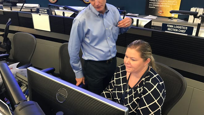Gov. Rick Scott visits with Florida Division of Emergency Management Meteorologist Amy Godsey Sunday after Hurricane Irma made landfall in the Florida Keys.