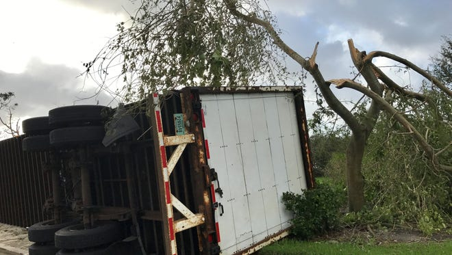 Hurricane Irma knocked a truck trailer onto the sidewalk and downed  trees off Creekside Boulevard in North Naples.