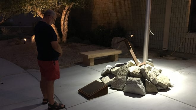 Palm Springs resident Richard Fluechtling observes the 9/11 memorial at the Palm Springs fire station on El Cielo Road four years ago.