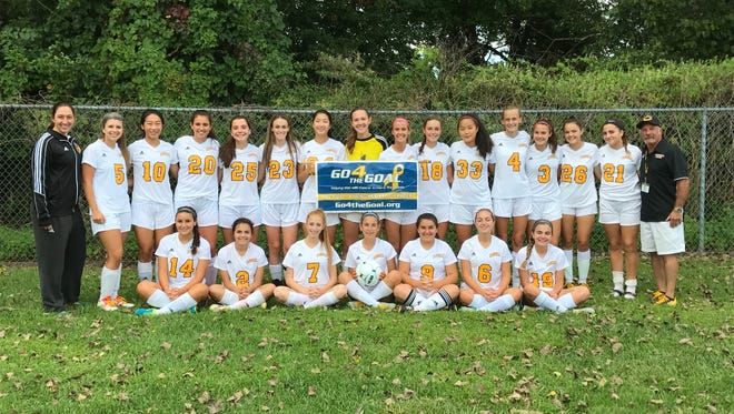 Members of the Cresskill High School Girls Varsity soccer team support non-profit Go4TheGoal during their first homecoming game of the season on Sept. 8 to raise awareness for pediatric cancer.
