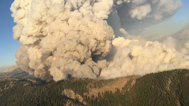 The Strawberry Fire blows up Monday afternoon. The fire has prompted road closures and evacuations in the vicinity of Swift Dam west of Dupuyer.