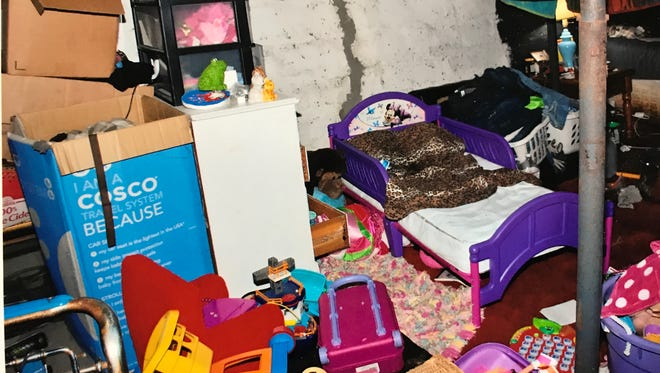 A police photo of the basement area of Michael Stagles' mother's house on Albemarle Street in Rochester where Brook Stagles slept.