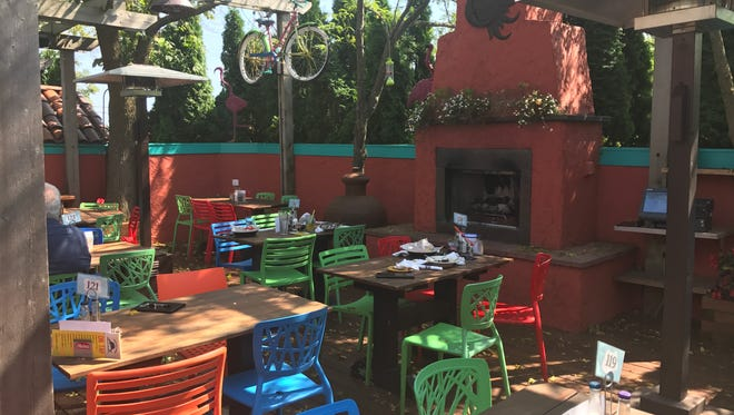 The Highland House has seating for approximately 300 on its patios which are adorned with fireplaces, trees and bright colors.