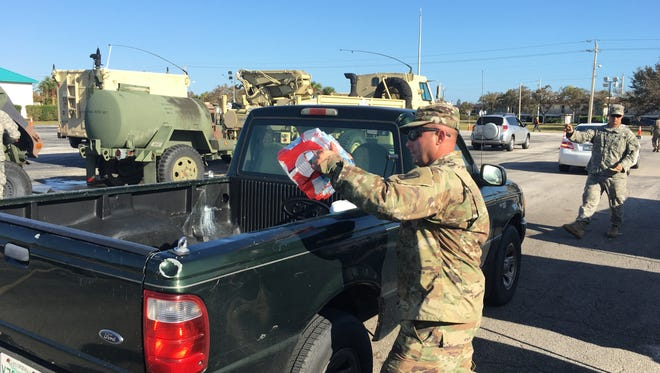 The 3/116 Bravo Battery Army National Guard is helping distribute cases of water at Cocoa Beach Jr./Sr. High School. Similar distributions are ongoing at sites in Cape Canaveral, Cocoa and Merritt Island.