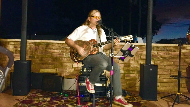 Blues guitarist Robin Scott performs during a recent gig at Marion's New American Restaurant, 106 W. Bonbright St.