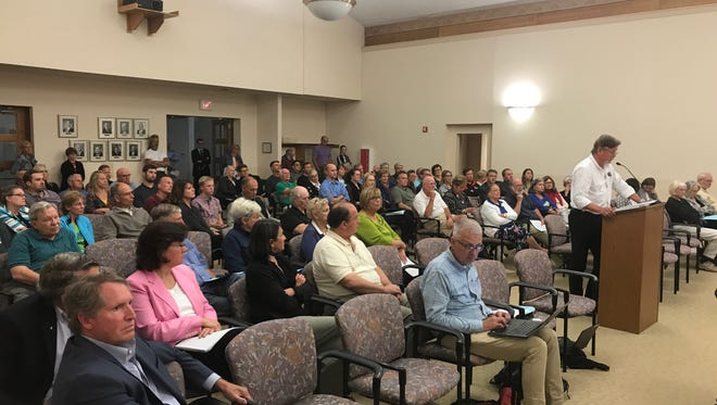 In a packed council chambers, Ranch Road resident Howard Schlei speaks in opposition to a 13-lot subdivision at 2100 W. Ranch Road.