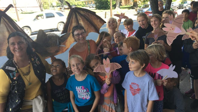 Students from The Learning Community School and ArtSpace Charter School take part in a live bat presentation at the Black Mountain Center for the Arts with naturalist Vicki Smith on Sept. 14. On their way into the gallery and theater, students stopped to appreciate the giant fiber art bat created by Theresa Coté. The third grade at W.D. Williams watched the presentation on Sept. 13.