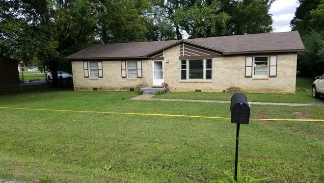 A woman and two children were found shot to death inside this home on Mills Drive in Clarksville Thursday morning.