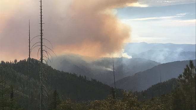 Smoke from the newly ignited Indigo Fire is seen here, north of the Chetco Bar Fire.