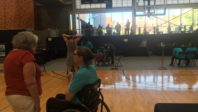 Participants at the Latino Disability Summit and Resource Fair enjoy live mariachi music in the Ability360 Sports and Fitness Center.