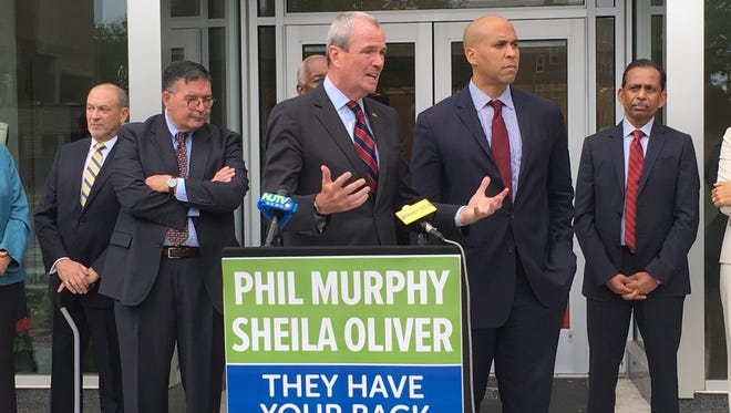 Democratic gubernatorial nominee Phil Murphy, pictured with Sen. Cory Booker, right, at a news conference in Trenton to announce workforce development plans if he's elected.