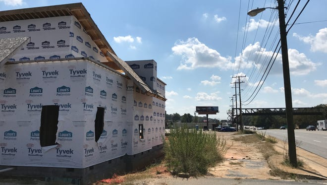 A reader wants to know what is being built on N. Pleasantburg Drive near the Bob Jones University pedestrian bridge. Sept 18, 2017