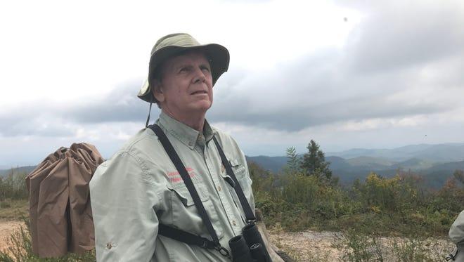 Ed Moorer keeps a sharp eye out for hawks migrating south over Sassafras Mountain.