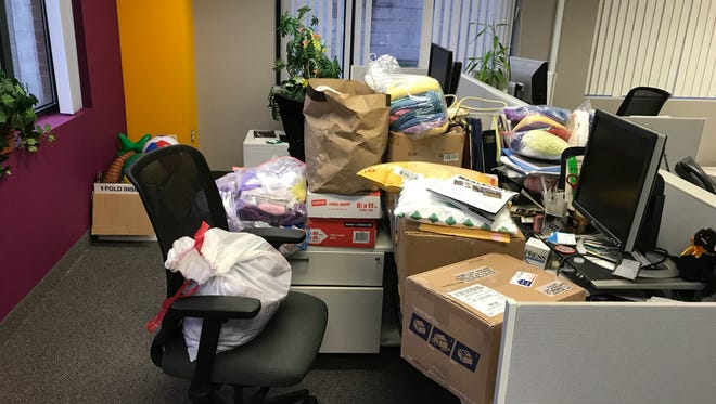 While I was out of the office Monday and Tuesday, readers filled my desk area with hats. Thanks so much!