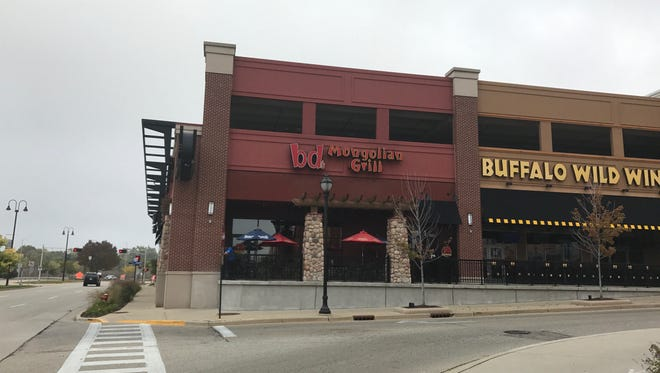 A 14-year-old girl allegedly punched a waitress on Sunday, May 13 at BD's Mongolian Grill in Bayshore Town Center.