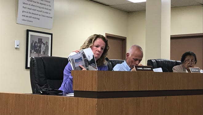 Montclair Planning Board member Carmel Loughman shows a photo during the Sept. 11 Planning Board meeting.