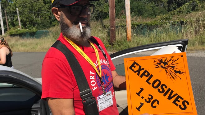 """Rahway resident Bruce Williams, who worked at Fort Monmouth from 1987 to 1999, purchased an """"explosives"""" sign at a fort sale and auction."""