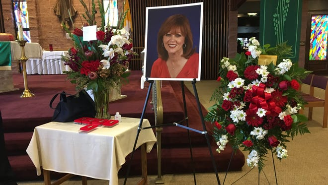 A photo of Pattie Daly Caruso near the altar at Sacred Heart Church on Saturday.
