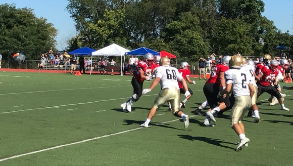 Somers' Tyler Carr takes a handoff in the Tuskers'