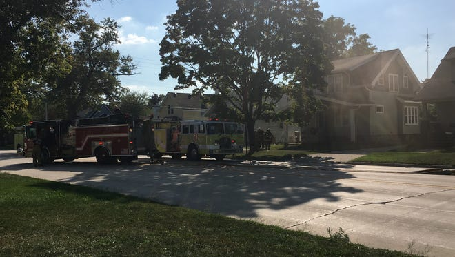 Firefighters respond to a fire at 1419 10th Ave. just before 4 p.m. on Sept. 24.
