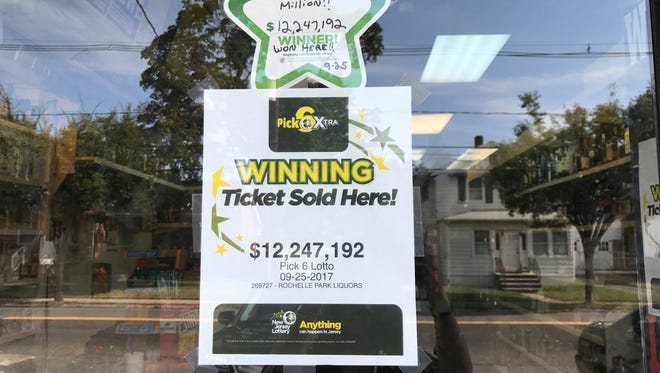 A sign posted at J.R. Wines & Liquors at 332 Rochelle Avenue in Rochelle Park on Tues., Sept. 26, 2017, announcing the winning ticket for the Pick-6 Xtra drawing was sold there. A lucky customer bought a ticket that matched all six numbers drawn Monday night for the $16.4 million jackpot, state lottery officials announced Tuesday. The cash value of the ticket was $12.2 million.