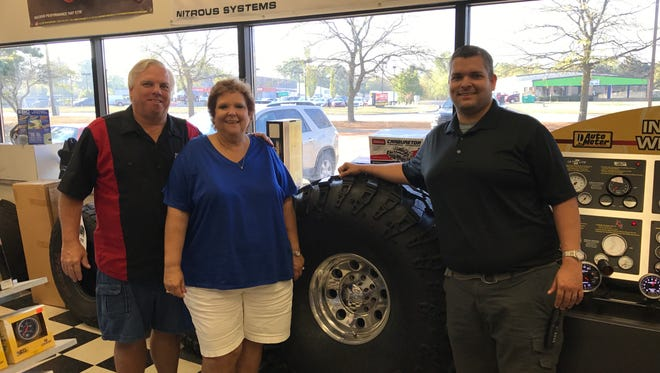 Mike, Deb and Brad Copeland show some of the high performance vehicle products the family sells at Diversified Creations, their custom vehicle build and parts shop in Genoa Township, on Tuesday, Sept. 26, 2017. The Copeland's purchased Virginia-based Arrington Performance. They will move the new business to town and expand it.