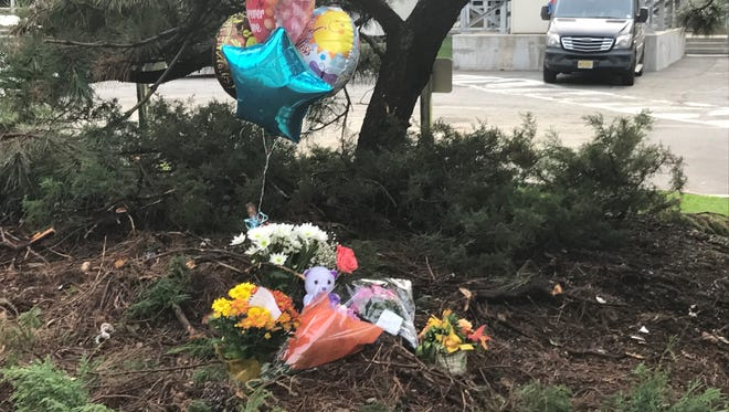 A makeshift memorial popped up at the scene of a horrific hit-and-run that killed a woman on Tuesday morning.