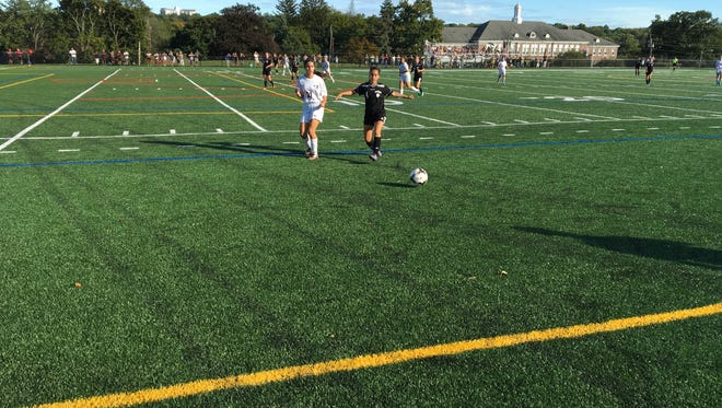 Freshmen Sara Cole of Verona (left) and Katherine Pachon of Cedar Grove (right) battle for the ball.