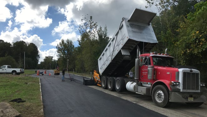 Road paving is underway this week nearthe Lakeside Manor town house site in Wanaque.