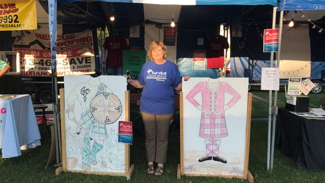 Event organizer Amy Luken-Richter stands by a booth promoting Cheviot's first Scottish Festival. The event will be Oct. 14-15.