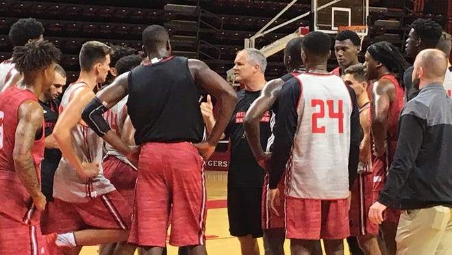 Steve Pikiell talks to his team after the first practice.