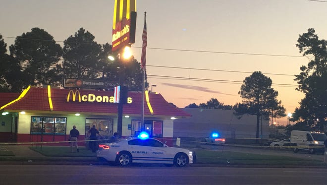 Yellow police tape surrounded four businesses near the McDonald's including a Citgo gas station, a pawn shop and a title loan business.