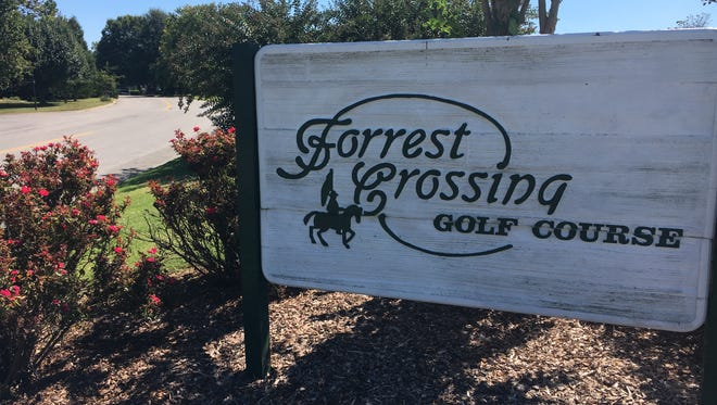 A sign at The Crossing Golf Course in Franklin still reflects its old name. American Golf Corporation, the course's owner, changed the name on Sept. 22.