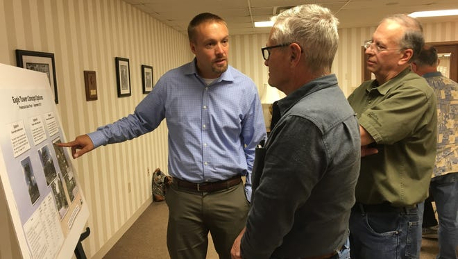 State Parks Director Ben Bergey, left, answers questions about the Eagle Tower concepts in Peninsula State Park asked by Tom Blackwood, the former superintendent of Peninsula State Park and Karl Erickson of Fish Creek Thursday, Sept. 28, 2017.