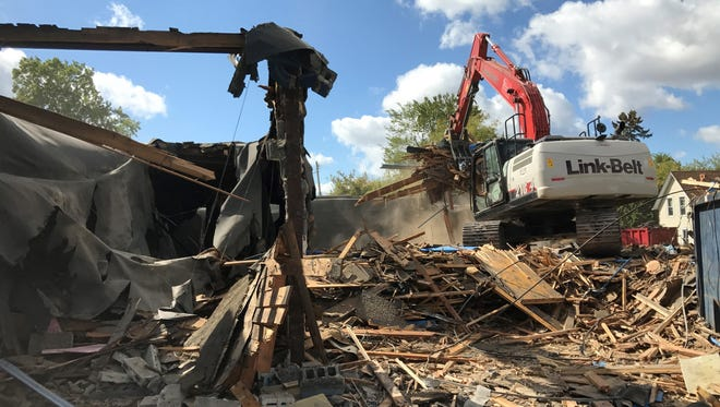 The razing of fire-damaged Fracaro's Lanes on Whitrerock Avenue  is underway. A shovel operator was clearing debris Friday, Sept. 29, at the site. The building was damaged beyond repair in a fire on Jan. 1, 2017.