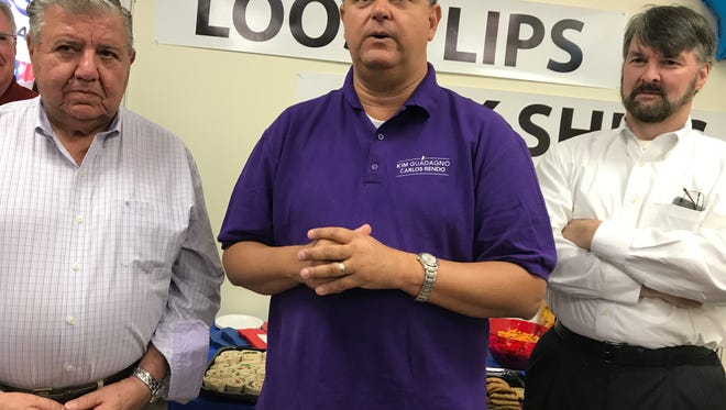 Woodcliff Lake Mayor and candidate for lieutenant governor Carlo Rendo, with Sen. Anthony R. Bucco, left, and Assemblyman Michael Patrick Carroll, right, speaks at the opening of a new Republican campaign headquarters in Rockaway. Sept. 30, 2017