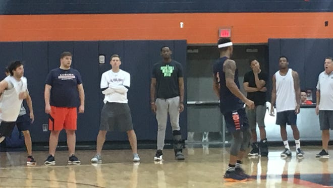 Auburn sophomore center Austin Wiley, with black t-shirt and boot on his left ankle, has been inactive for several practices due to pain in his left leg. Wiley is scheduled for an MRI Wednesday.