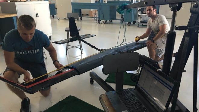 Vincent Besompes and Benjamin Buisson, who are studying at the Florida Institute of Technology on leave from the French Air Force Academy, work on a Northrop Grumman-sponsored unmanned aerial vehicle (UAV) for the university's annual student design showcase. The team used Siemens software to analyze the vibrational modes of the UAV.