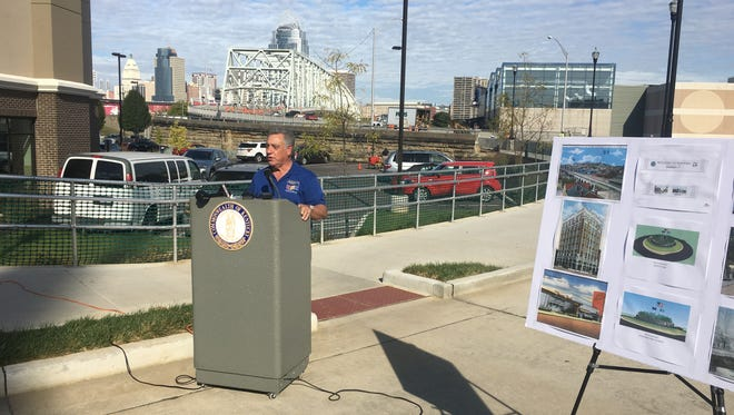 Southbank Partners Jack Moreland unveils the proposed entryways at the site of one of the roundabouts in front of the Taylor-Southgate Bridge.