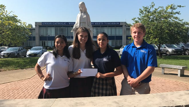 Left to right: Union Catholic students Janessa Mendoza class of 2018, Andrey David class of 2019, scholarship recipient Lilyana Roque class of 2021, Michael Fox class of 2020.