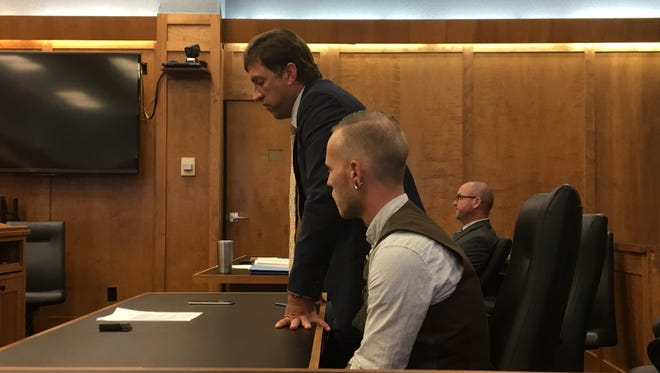 Nicholas S. Jernigan, in the foreground, pleaded guilty to 10 charges related to child pornography Wednesday, Oct. 4, 2017. Jernigan's defense attorney, James Mayer III, is standing, and Richland County assistant prosecutor Brandon Pigg is sitting in the background.